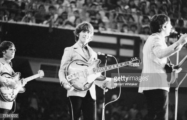 John Lennon George Harrison and Paul McCartney onstage at the Beatles concerts at Tokyos Budokan Hall Japan 2nd July 1966
