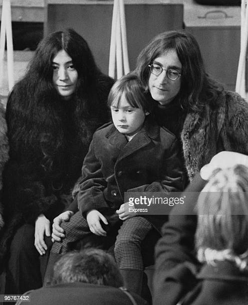 John Lennon his son Julian and Yoko Ono pose for photographers at Internel Studios in Stonebridge Park Wembley during a rehearsal for the Rolling...