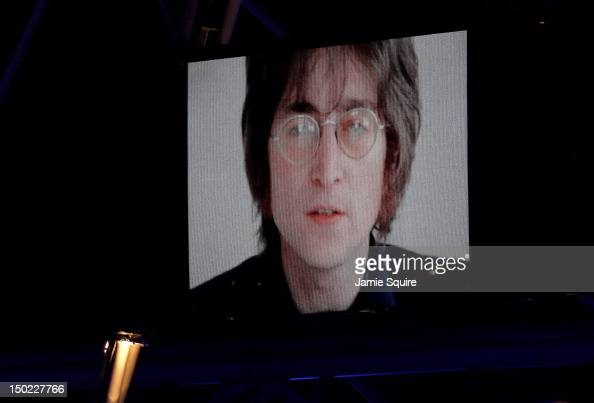 John Lennon is displayed on a screen inside the stadium during the Closing Ceremony on Day 16 of the London 2012 Olympic Games at Olympic Stadium on...