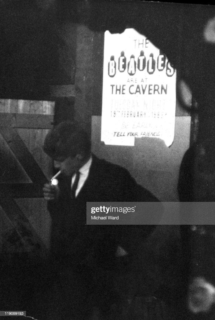 John Lennon lighting a cigarette In 'The Cavern' 1964;.