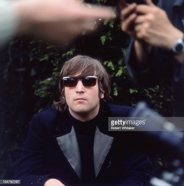 John Lennon of the Beatles in Chiswick House grounds London during the making of promotional films for the single 'Rain' and 'Paperback Writer' 20th...
