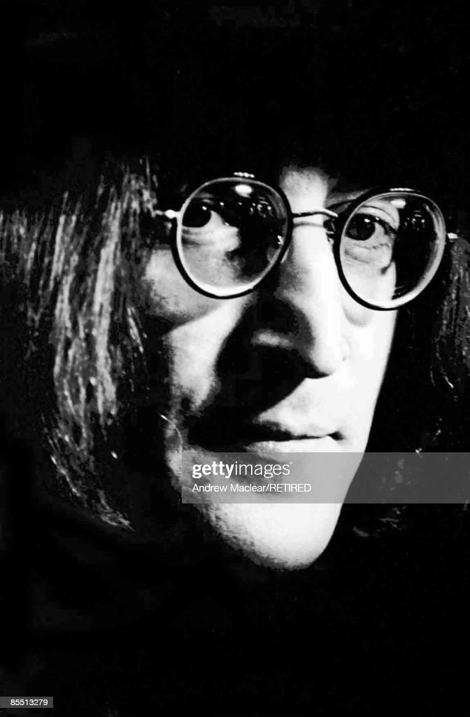 Photo of John LENNON; while in The Beatles, posed on the set of 'Rock 'n' Roll Circus'