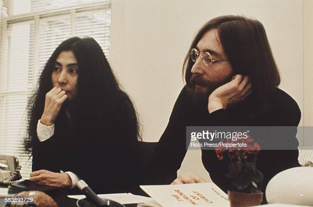 John Lennon of The Beatles pictured with his wife Yoko Ono in the Apple offices in London circa 1969 A copy of Wlhelm Reich's book 'The Murder of...