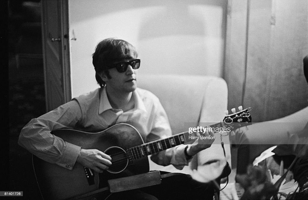 <a gi-track='captionPersonalityLinkClicked' href=/galleries/search?phrase=John+Lennon&family=editorial&specificpeople=91242 ng-click='$event.stopPropagation()'>John Lennon</a> (1940 - 1980) of the Beatles plays the guitar in a hotel room in Paris, 16th January 1964.