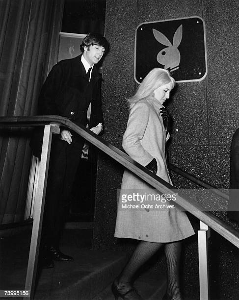 John Lennon of the rock and roll band 'The Beatles' and his wife Cynthia Lennon visit The Playboy Club on February 9 1964 in New York City New York