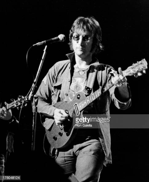 John Lennon performs at Live In New York City Benefit Concert on August 30 1973 at Madison Square Garden in New York City