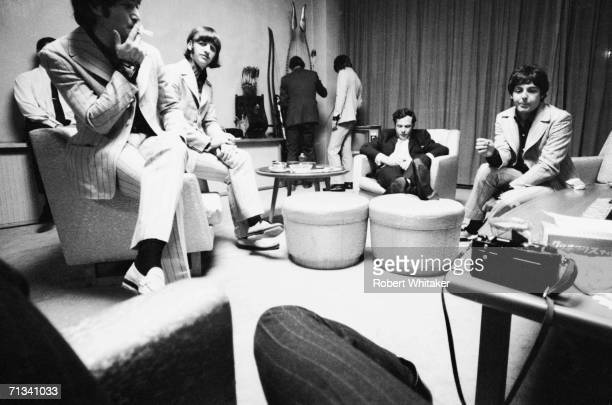 John Lennon Ringo Starr Beatles road manager Neil Aspinall George Harrison Beatles manager Brian Epstein and Paul McCartney backstage at Tokyos...