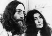 John Lennon singer songwriter and guitarist of British pop group The Beatles with his wife Yoko Ono listening to the playback of one of their tapes