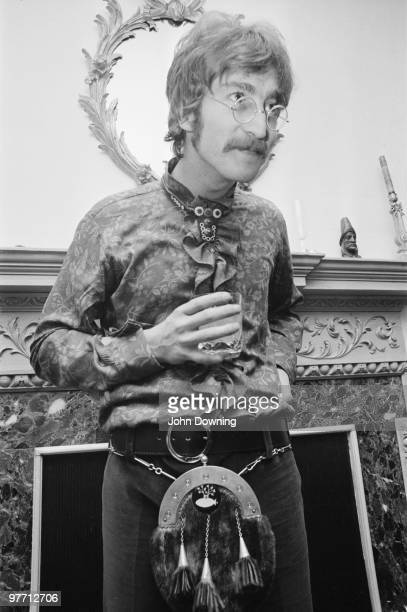 John Lennon wearing a frilly shirt and a sporran at the press launch for the Beatles' new album 'Sergeant Pepper's Lonely Hearts Club Band' held at...