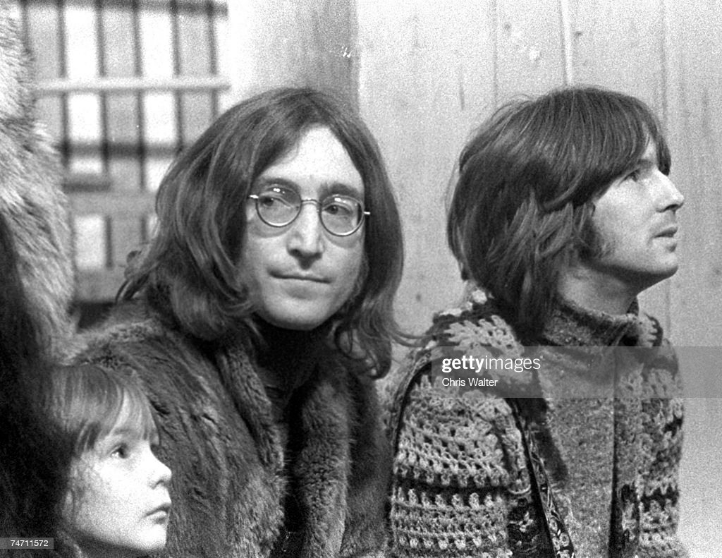 John Lennon with Julian Lennon and Eric Clapton at the Rolling Stones' 'Rock & Roll Circus' TV show filming, 1968 in London, United Kingdom.