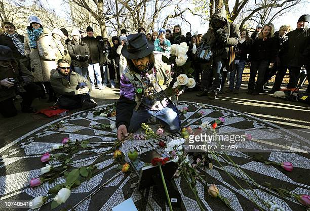 John Lennon's fans gather at New York City's Strawberry Fields in Central Park December 8 2010 in New York Fans in several cities held vigils to mark...