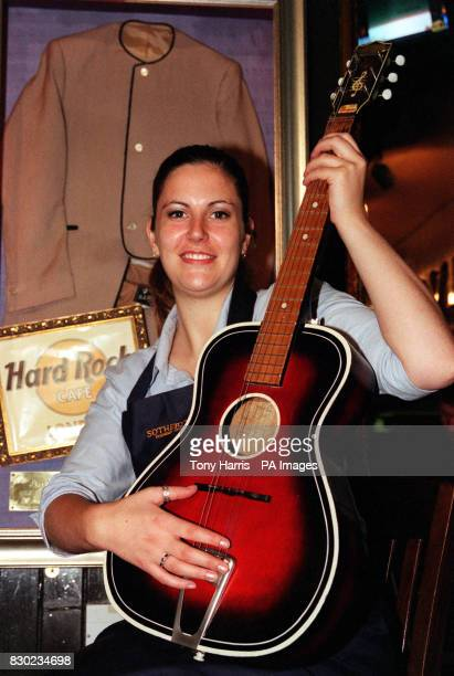 John Lennon's Gallotone 'Champion' acoustic guitar from the late 1950's held by Sotheby's Sarah Butler was on view at The Hard Rock Cafe London The...
