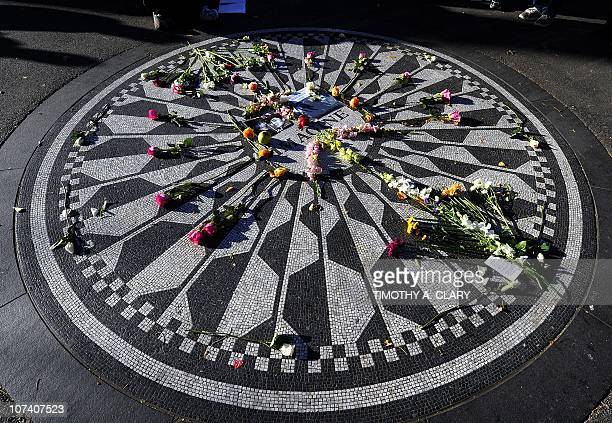 John Lennon's leave flowers at New York City's Strawberry Fields in Central Park December 8 2010 in New York Fans in several cities held vigils to...