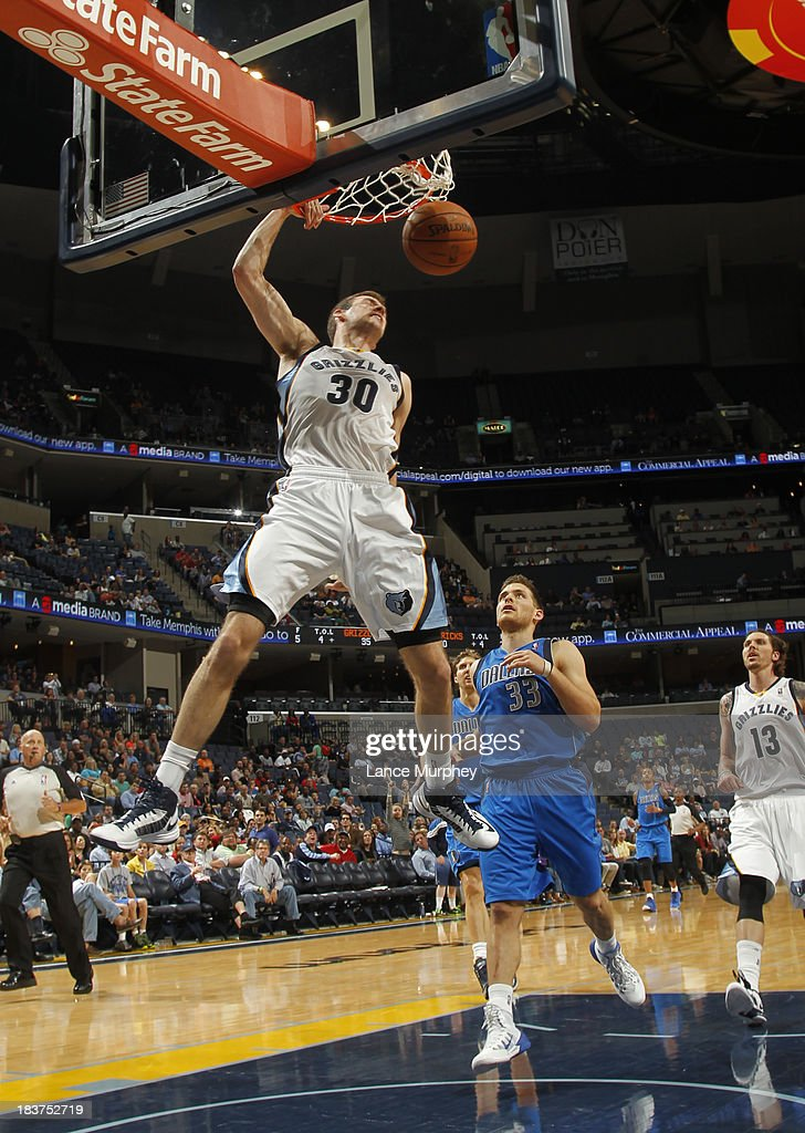 John Leuer #30 of the Memphis Grizzlies dunks against <a gi-track='captionPersonalityLinkClicked' href=/galleries/search?phrase=Gal+Mekel&family=editorial&specificpeople=6141738 ng-click='$event.stopPropagation()'>Gal Mekel</a> #33 of the Dallas Mavericks during a game on October 9, 2013 at FedExForum in Memphis, Tennessee.