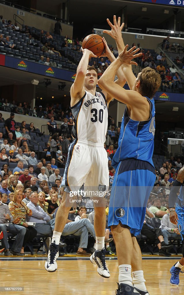 John Leuer #30 of the Memphis Grizzlies shoots against <a gi-track='captionPersonalityLinkClicked' href=/galleries/search?phrase=Dirk+Nowitzki&family=editorial&specificpeople=201490 ng-click='$event.stopPropagation()'>Dirk Nowitzki</a> #41 of the Dallas Mavericks during a game on October 9, 2013 at FedExForum in Memphis, Tennessee.