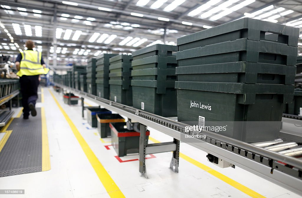 John Lewis Plc-branded crates sit stacked on a Knapp AG warehouse logistics system at the company's semi-automated distribution centre in Milton Keynes, U.K., on Monday, Dec. 3, 2012. An index of U.K. retail sales rose to a five-month high in November, according to a monthly report from the Confederation of British Industry. Photographer: Simon Dawson/Bloomberg via Getty Images