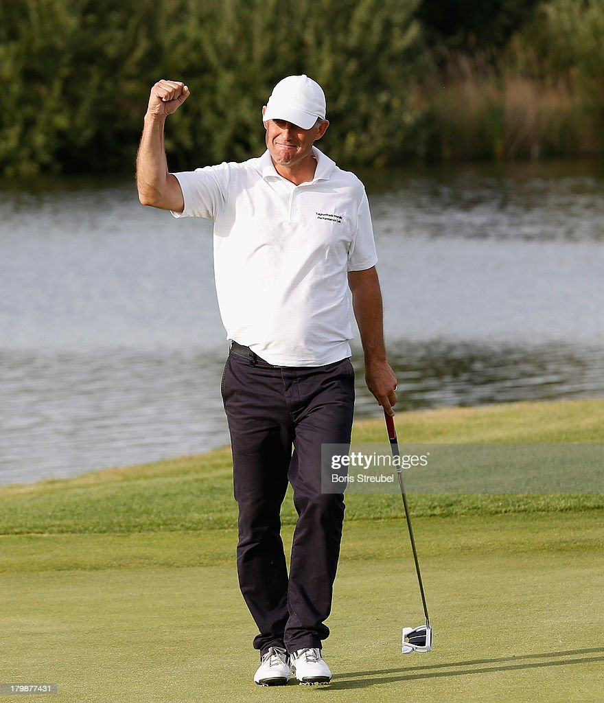 John Lindberg of Sweden celebrates on the18th green during the second round on day two of the WINSTONgolf Senior Open played at WINSTONgolf on September 7, 2013 in Schwerin, Germany.