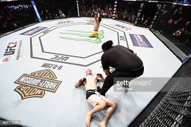 John Lineker celebrates his knockout victory over Michael McDonald in their bantamweight bout during the UFC Fight Night event on July 13 2016 at...