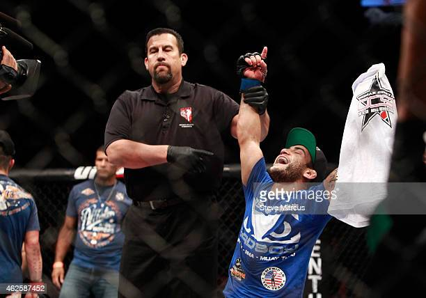 John Lineker celebrates his victory over Ian McCall after their flyweight bout during UFC 183 at the MGM Grand Garden Arena on January 31 2015 in Las...