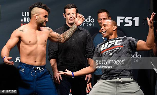 John Lineker of Brazil and John Dodson faceoff during the UFC Fight Night weighin at the Oregon Convention Center on September 30 2016 in Portland...