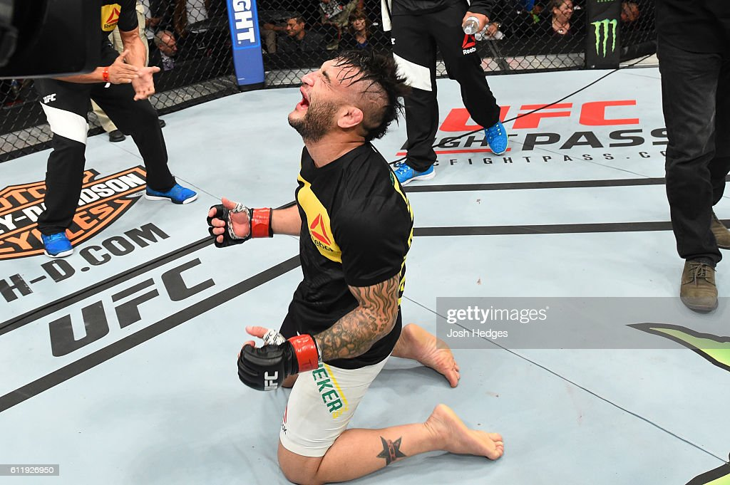 John Lineker of Brazil celebrates after defeating John Dodson by split decision in their bantamweight bout during the UFC Fight Night event at the Moda Center on October 1, 2016 in Portland, Oregon.