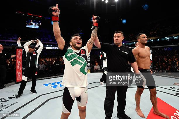 John Lineker of Brazil celebrates after defeating Rob Font by unanimous decision in their bantamweight bout during the UFC 198 event at Arena da...