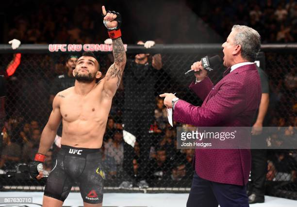 John Lineker of Brazil is introduced by UFC Octagon announcer Bruce Buffer before facing Marlon Vera of Ecuador in their bantamweight bout during the...