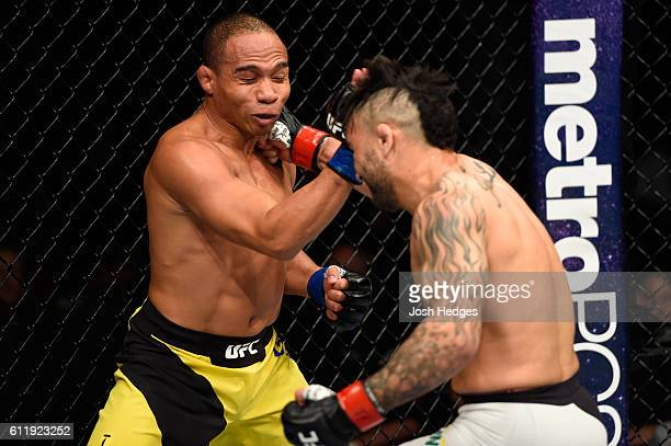 John Lineker of Brazil punches John Dodson in their bantamweight bout during the UFC Fight Night event at the Moda Center on October 1 2016 in...