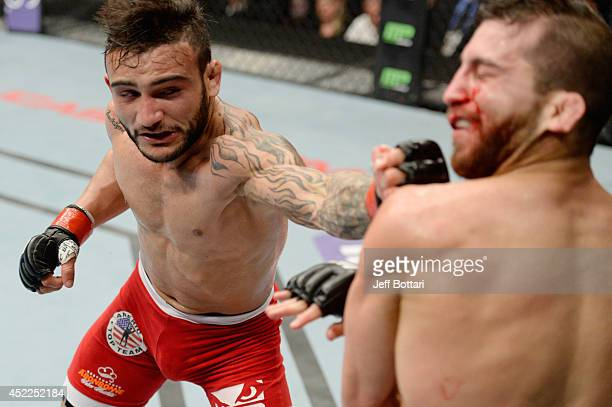 John Lineker punches Alptekin Ozkilic in their flyweight bout during the UFC Fight Night event at Revel Casino on July 16 2014 in Atlantic City New...