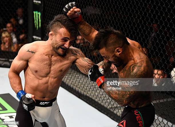 John Lineker punches Francisco Rivera in their bantamweight bout during the UFC 191 event inside MGM Grand Garden Arena on September 5 2015 in Las...