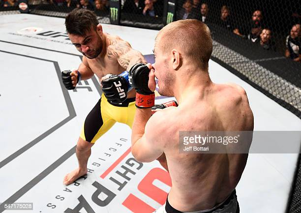 John Lineker punches Michael McDonald in their bantamweight bout during the UFC Fight Night event on July 13 2016 at Denny Sanford Premier Center in...