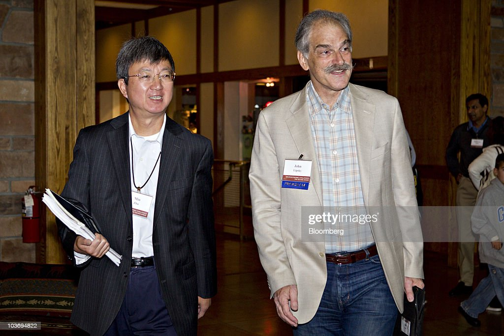 John Lipsky, first deputy managing director at the International Monetary Fund (IMF), right, arrives with Zhu Min, deputy governor of the People's Bank of China, to the morning session of the Federal Reserve Bank of Kansas City annual symposium near Jackson Hole, Wyoming, U.S., on Saturday, Aug. 28, 2010. Federal Reserve Chairman Ben S. Bernanke said the U.S. central bank 'will do all that it can' to ensure a continuation of the economic recovery, and outlined steps it might take if the growth slows. Photographer: Andrew Harrer/Bloomberg via Getty Images