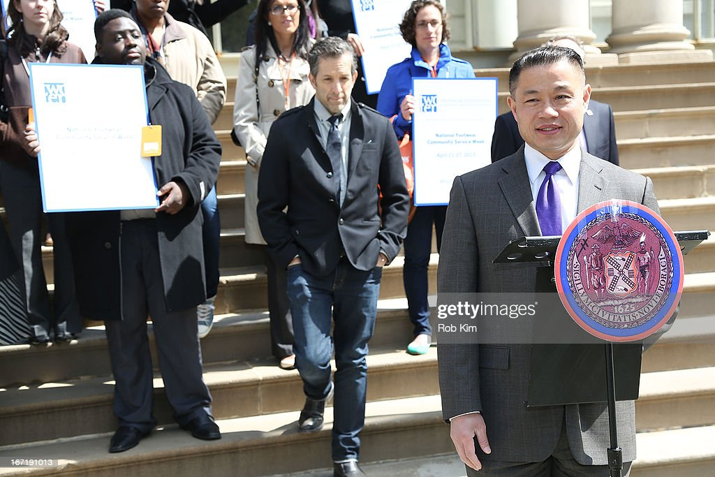 John Liu and Kenneth Cole (rear) attend the 2013 Footwear Cares Community Service Week and National Volunteer Week announcement at City Hall on April 22, 2013 in New York City.