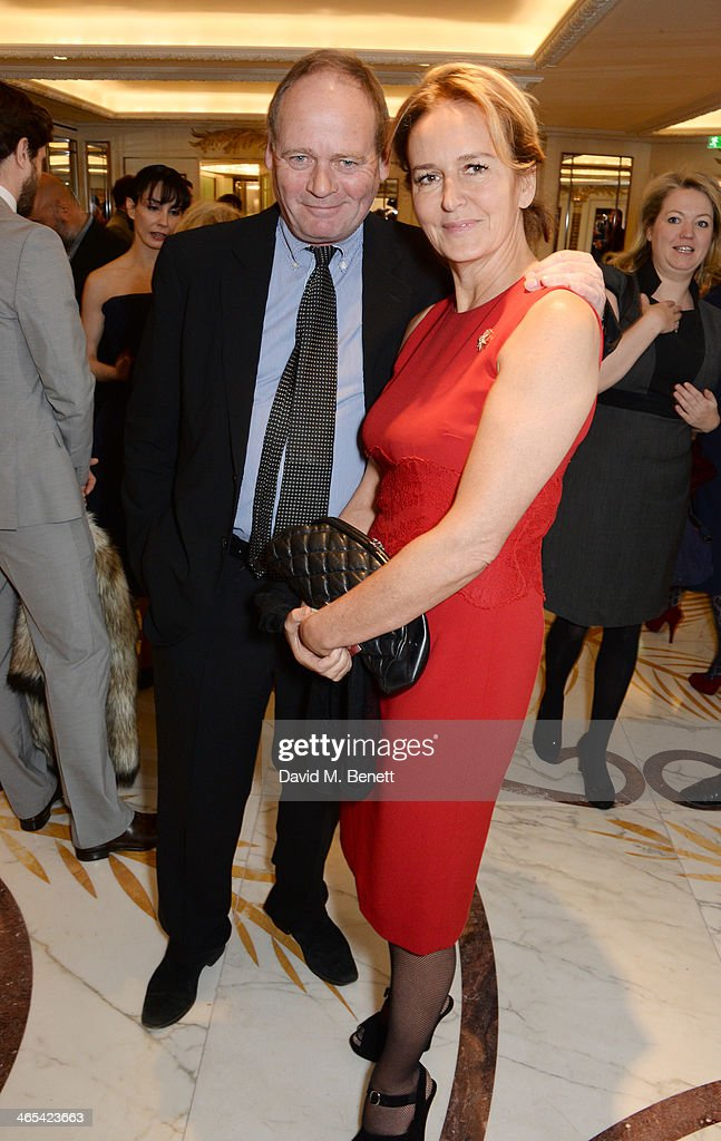 John Lloyd (L) and Caroline Michel attend a drinks reception at the South Bank Sky Arts awards at the Dorchester Hotel on January 27, 2014 in London, England.
