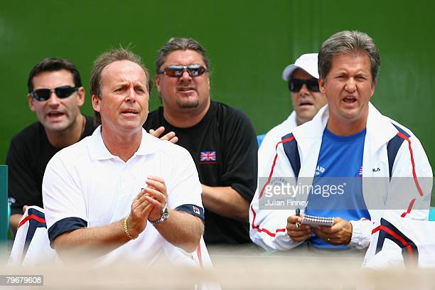 John Lloyd captain of Great Britain gives support with Roger Draper Peter Lundgren and Louis Cayer of the LTA as Jamie Murray and Ross Hutchins of...