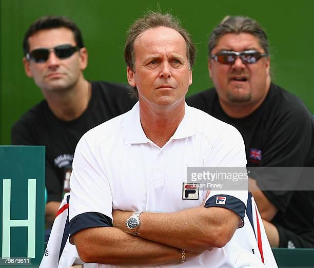 John Lloyd captain of Great Britain watches on with Roger Draper and Peter Lundgren of the LTA as Jamie Murray and Ross Hutchins of Great Britain...