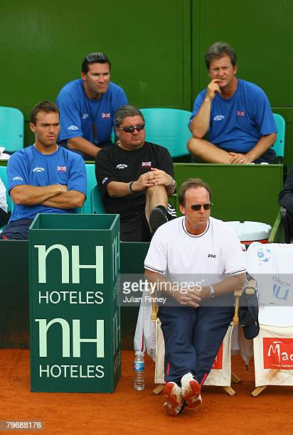 John Lloyd captain of Great Britain with Roger Draper Louis Cayer Ross Hutchins and Peter Lundgren watch the match between Alex Bogdanovic of Great...