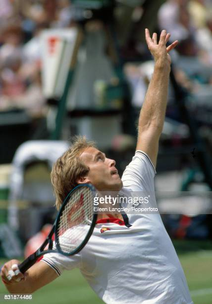 John Lloyd of England in action during a men's singles match at the Wimbledon Lawn Tennis Championships in London circa June 1985 Lloyd was defeated...