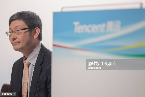 John Lo chief financial officer of Tencent Holdings Ltd attends a news conference in Hong Kong China on Wednesday March 22 2017 Tencent Holdings is...