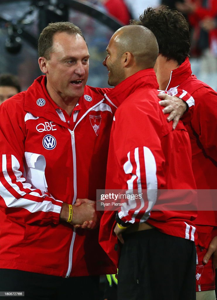 John Longmire, coach f the Swans , celebrates after the AFL First Semi Final match between the Sydney Swans and the Carlton Blues at ANZ Stadium on September 14, 2013 in Sydney, Australia.