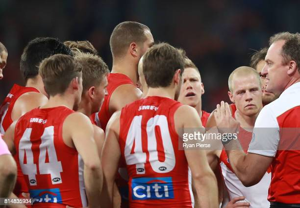 John Longmire coach of the Swans addresses his players during the round 17 AFL match between the Greater Western Sydney Giants and the Sydney Swans...