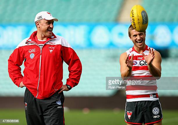 John Longmire coach of the Swans and Kieren Jack of the Swans look on during a Sydney Swans AFL training session at the Sydney Cricket Ground on May...