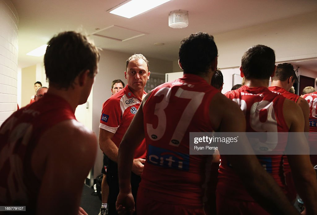 John Longmire, coach of the Swans, congratulates his players after the round two AFL match between the Sydney Swans and the Gold Coast Suns at SCG on April 6, 2013 in Sydney, Australia.