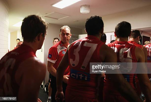 John Longmire coach of the Swans congratulates his players after the round two AFL match between the Sydney Swans and the Gold Coast Suns at SCG on...