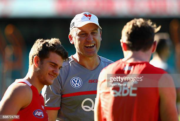 John Longmire coach of the Swans shares a joke with his players during a Sydney Swans AFL training session at the Sydney Cricket Ground on June 8...