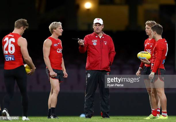 John Longmire coach of the Swans speaks to Isaac Heeney of the Swans during a Sydney Swans AFL media session at the Sydney Cricket Ground on June 6...