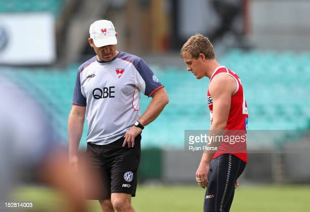 John Longmire coach of the Swans speaks to Luke Parker of the Swans during a Sydney Swans AFL training session at Sydney Cricket Ground on September...