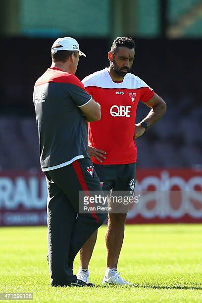 John Longmire coach of the Swans speaks with Adam Goodes of the Swans during a Sydney Swans AFL training session at Sydney Cricket Ground on April 28...
