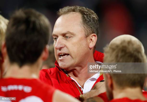 John Longmire Senior Coach of the Swans addresses his players during the 2017 AFL round 20 match between the Geelong Cats and the Sydney Swans at...