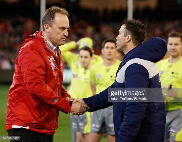 John Longmire Senior Coach of the Swans shakes hands with Chris Scott Senior Coach of the Cats during the 2017 AFL Second Semi Final match between...